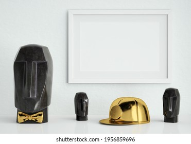 White mock up picture frame on white plaster wall with simple, modern marble head sculptures and golden mine helmet; landscape orientation stylish photo frame mockup; 3D rendering, 3D illustration