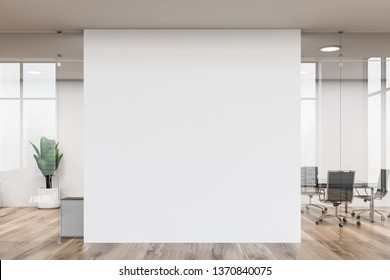 White modern office interior with glass walls, wooden floor, long black meeting room table with metal chairs and white mock up wall in the center. 3d rendering