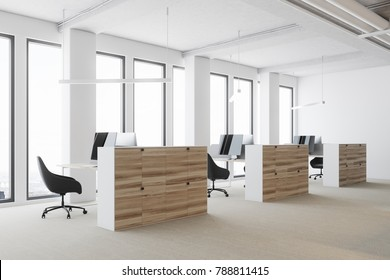White open space office environment with a concrete floor, large windows, and wooden cubicles with computer tables. 3d rendering mock up