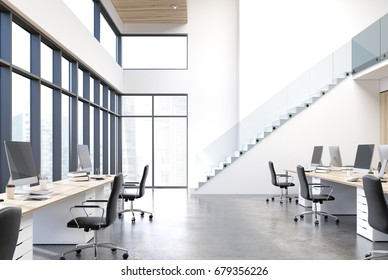 White open space office interior with panoramic windows, two rows of white computer tables with monitors on them, black chairs and stairs in the corner. Wooden ceiling. 3d rendering mock up