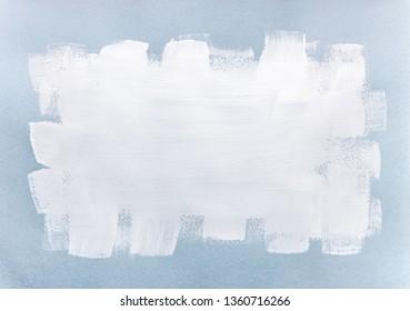 white paint brush stroke over light blue textured paper background
