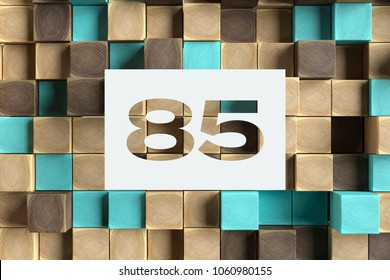 White Paper-Cut Number 85 on the Wood Pattern With Blue Dots on Background. 3D Illustration of Number 85 Eighty-Five for Wallpapers and Abstract Backgrounds.