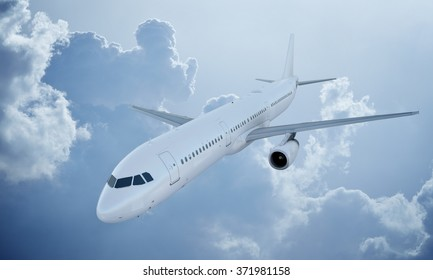 White plane flying in sky and clouds. Passenger airplane airbus a321