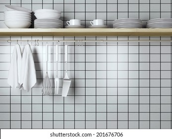 White plates on the wooden shelf, kitchen cooking utensils. Steel spatulas, whisk and towel in front of wall.