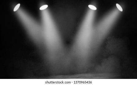 White projector. Spotlight stage with smoke on black background.Design element.