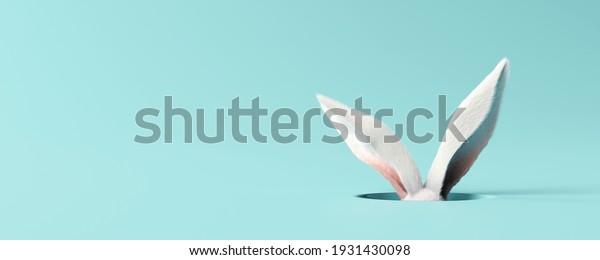 White rabbit ear on pastel blue background. Easter day. 3d rendering