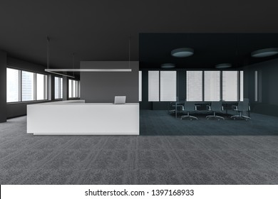 White reception desk with laptop computer on it standing in modern gray office with carpeted floor and glass wall conference room. 3d rendering