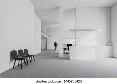 White reception desk with laptop on it standing in modern office waiting room with white walls, carpeted floor and row of black chairs. Open space area in background. 3d rendering