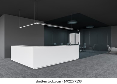 White reception table with laptop computer on it standing in modern gray office with carpeted floor and glass wall conference room. 3d rendering