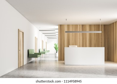 White reception table standing in a modern company office hall with wooden walls and a white floor. Concept of business interior. 3d rendering mock up