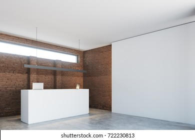 White reception table with two laptops is standing in a brick wall office lobby under a narrow horizontal window. Side view. 3d rendering mock up