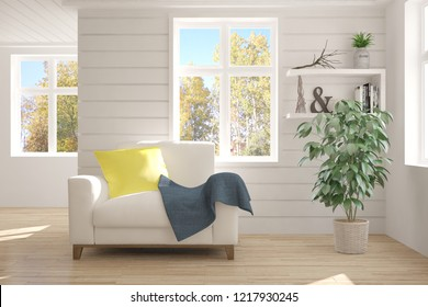 White room with armchair and autumn landscape in window. Scandinavian interior design. 3D illustration