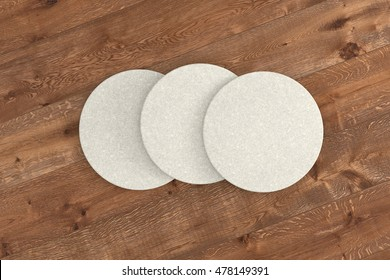 White round coasters. Isolated on wood background. 3d render
