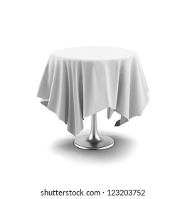 White round table and cloth isolated on a white background