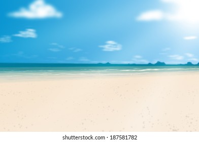 White sand beach in summer with palm leaves foreground.