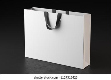 White shopping bag on a dark beton floor. Mock Up. 3d rendering
