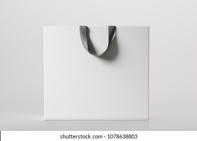 White shopping bag on a grey background. 3d rendering mock up