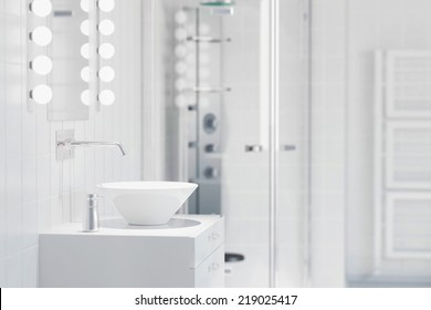 White sink in a modern bathroom with water tap and mirror