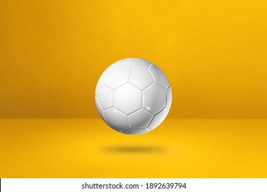 White soccer ball isolated on a yellow studio background. 3D illustration