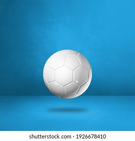 White soccer ball isolated on a blue studio background. 3D illustration
