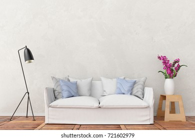 white sofa in front of plaster wall with lamp and flower