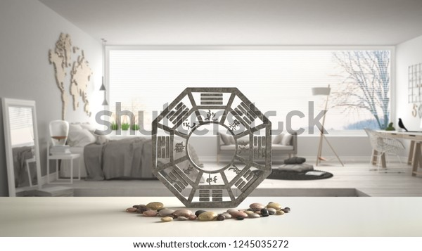 White table shelf with bagua and pebble stone, white scandinavian bedroom with big panoramic window, zen concept interior design, feng shui template idea background, 3d illustration