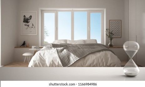 White table or shelf with crystal hourglass measuring the passing time over modern bedroom with panoramic window, architecture interior design, copy space background, 3d illustration