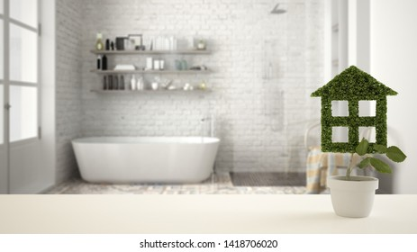 White table top or shelf with green plant in pot shaped like house, modern blurred bathroom with bathtub in the background, interior design, real estate, eco architecture concept idea, 3d illustration