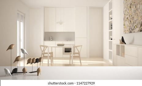 White table top or shelf with minimalistic bird ornament, birdie knick - knack over blurred contemporary white kitchen, modern interior design, 3d illustration