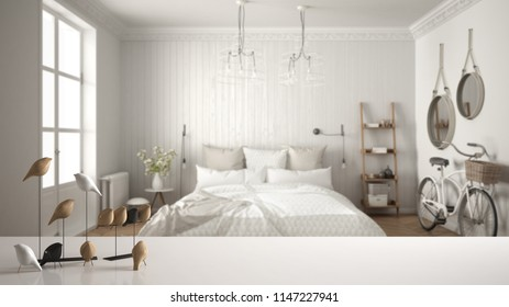White table top or shelf with minimalistic bird ornament, birdie knick - knack over blurred scandinavian bedroom, modern interior design, 3d illustration