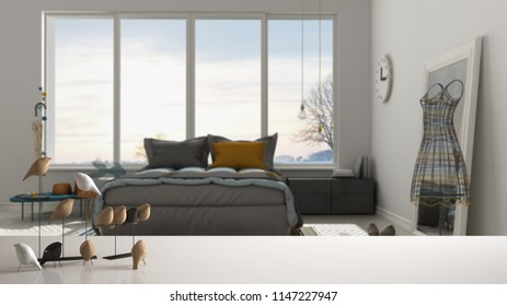 White table top or shelf with minimalistic bird ornament, birdie knick - knack over blurred contemporary bedroom with big panoramic window, modern interior design, 3d illustration