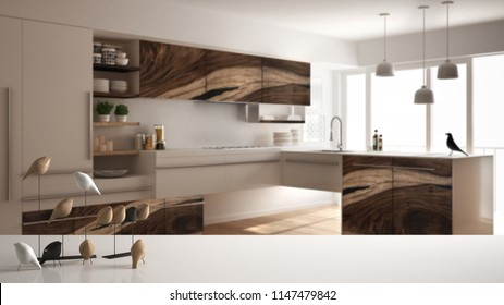 White table top or shelf with minimalistic bird ornament, birdie knick - knack over blurred contemporary wooden kitchen, modern interior design, 3d illustration