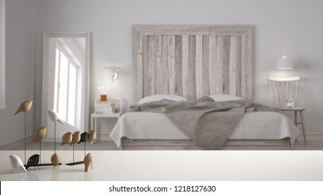 White table top or shelf with minimalistic bird ornament, birdie knick - knack over blurred scandinavian bedroom with wooden headboard, modern interior design, 3d illustration