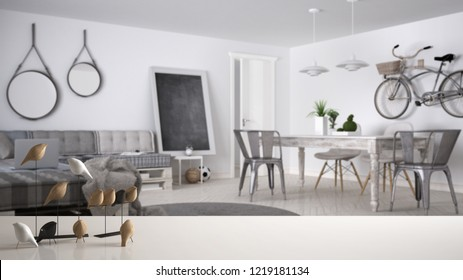 White table top or shelf with minimalistic bird ornament, birdie knick - knack over blurred modern living room with pallet sofa and vintage dining table, modern interior design, 3d illustration