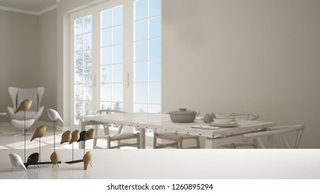 White table top or shelf with minimalistic bird ornament, birdie knick - knack over blurred classic kitchen with dining table laid for two, panoramic window, modern interior design, 3d illustration