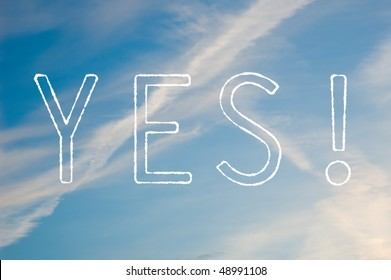 A white text saying Yes! against a blue sky.