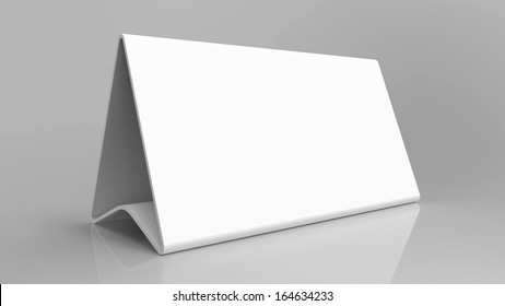 White triangular sign standing on a shiny grey background. Room for you text.