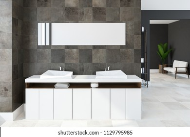White twin sink vanity unit attached to a black tile bathroom wall with a long horizontal mirror hanging above it. Concept of a cozy home and relaxation. 3d rendering