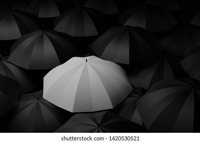 White umbrella in the midst of black. Difference concepts. 3D rendering.