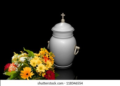 White urn with a bouquet of flowers