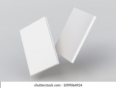 White vertical two blank book cover flying over white background with clipping path around each book cover. Front and back cover views. 3d illustration