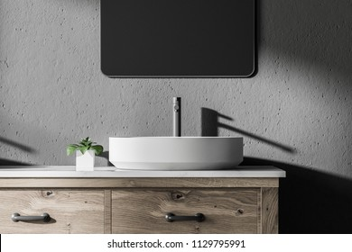 White vessel sink standing in a modern bathroom interior with a wooden countertop and a vertical mirror. Gray walls. 3d rendering mock up