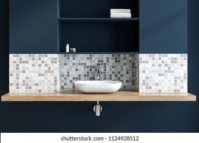 White vessel sink standing in a mosaic and dark blue bathroom interior with a wooden countertop. 3d rendering mock up