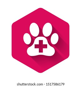 White Veterinary clinic symbol icon isolated with long shadow. Cross hospital sign. A stylized paw print dog or cat. Pet First Aid sign. Pink hexagon button