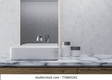White wall bathroom interior with a white marble shelf with a white angular sink on it and a narrow vertical mirror. 3d rendering mock up