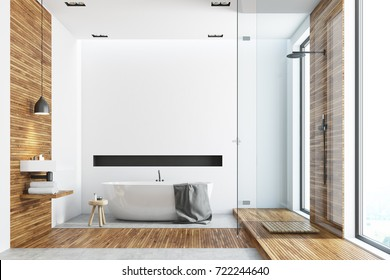 White and wooden bathroom interior with a wooden floor, tall windows, a round white tub, an angular sink and a glass shower corner. 3d rendering mock up