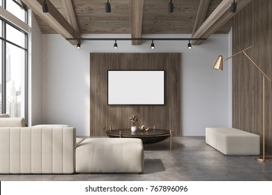 White and wooden living room interior with a concrete floor, loft windows, a soft white sofa, a coffee table and a poster. 3d rendering mock up