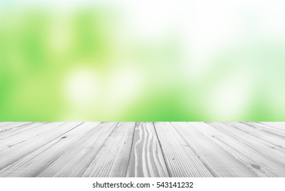 White Wooden Table with Blurred Backgound Behind. 3D Rendering