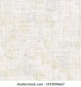 Whitewash linen texture seamless background. Cotton cloth effect in weathered sun bleached coastal living style. Irregular blotched mottled pastel white fabric material. Beach wedding blank backdrop