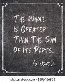 The whole is greater than the sum of its parts - ancient Greek philosopher Aristotle quote written on framed chalkboard